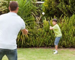 10198282-happy-father-and-his-son-playing-baseball